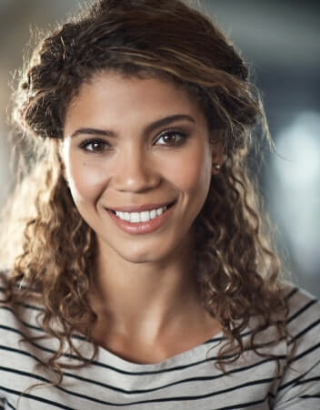 Young woman in striped shirt smiling