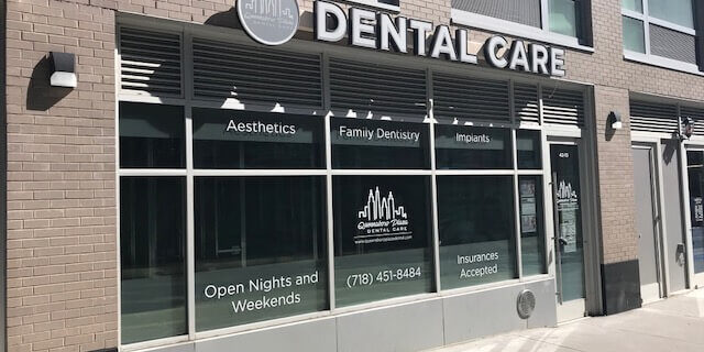 Outside view of the Queensboro Plaza Dental Care sign outside their dental office in Long Island City
