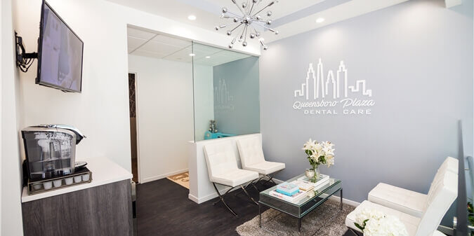Reception and waiting area inside the office of Queensboro Plaza Dental Care in Long Island City