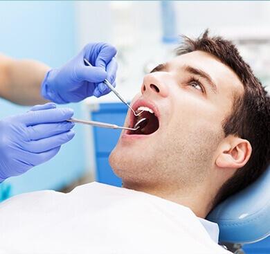 man receiving dental work